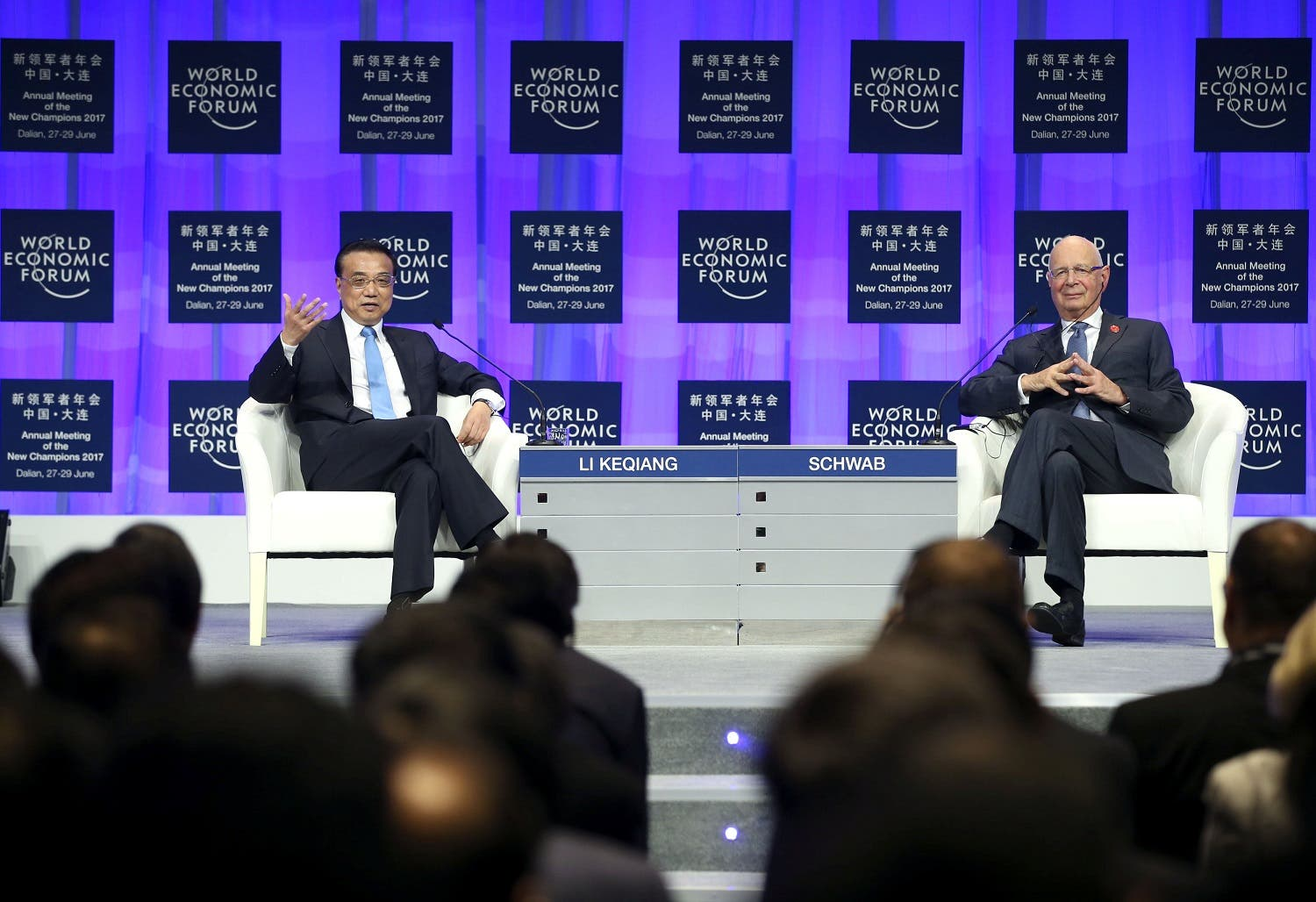 Chinese Premier Li Keqiang (left) and WEF Founder and Executive Chairman Klaus Schwab attend the World Economic Forum in Dalian, China, on June 27, 2017. (Reuters)