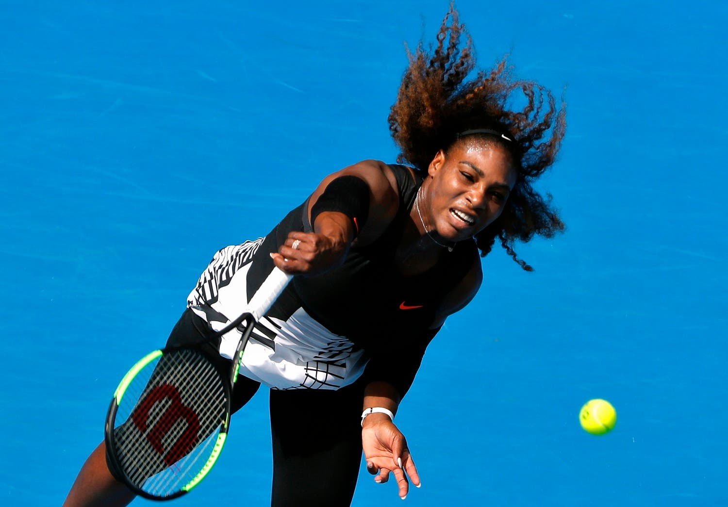 Serena Williams serves during her fourth round match against Czech Republic's Barbora Strycova. Reuters
