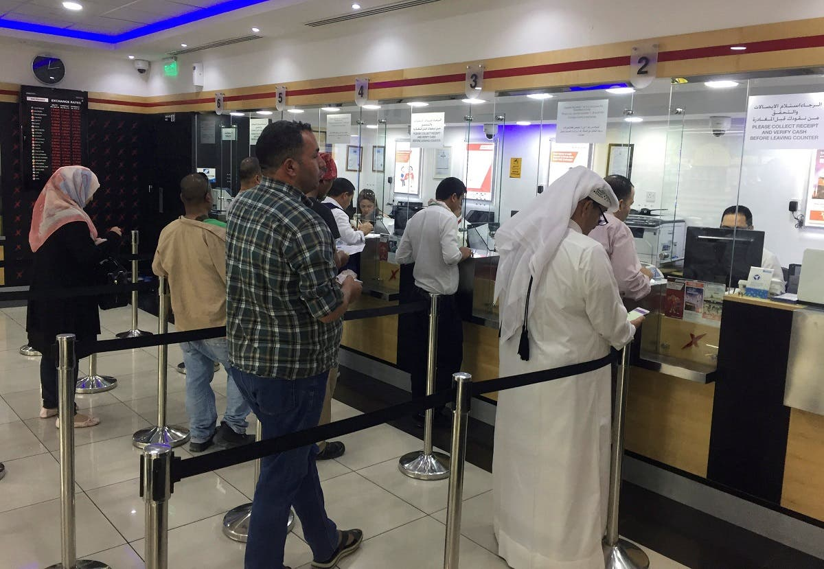 People exchange money at a money exchange office in Doha, Qatar, June 11, 2017. (Reuters)