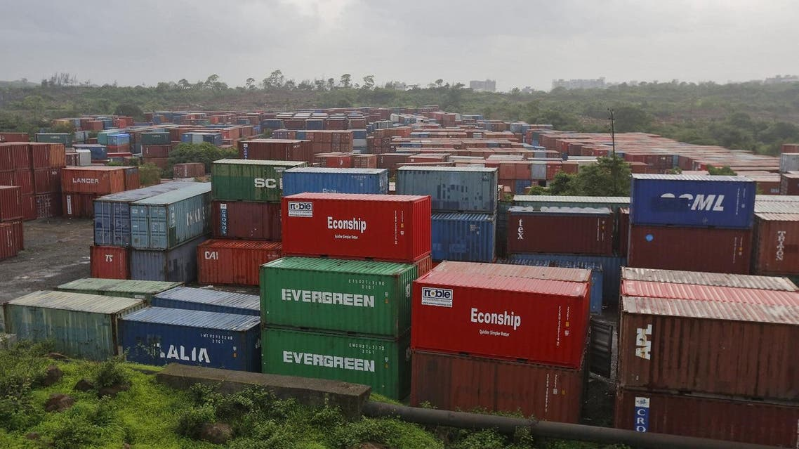 Cargo containers are seen stacked outside the container terminal of Jawaharlal Nehru Port Trust in Mumbai, India. (Reuters)