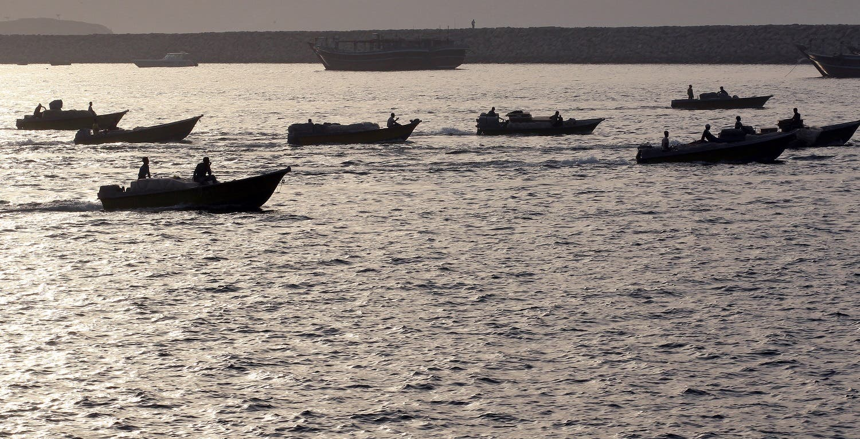 Iranian boats loaded with smuggled goods cruise through the Strait of Hormuz near Oman's Khasab port on July 14, 2012. (File photo: AFP)