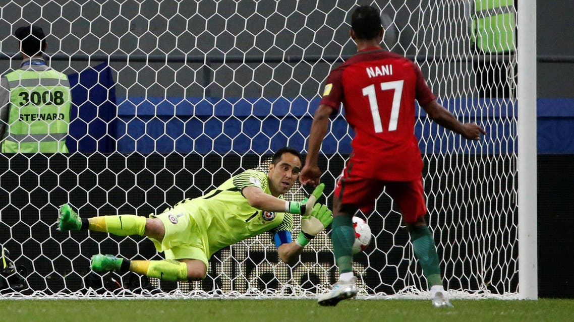Chile's Claudio Bravo saves from Portugal's Nani to win the penalty shootout REUTERS