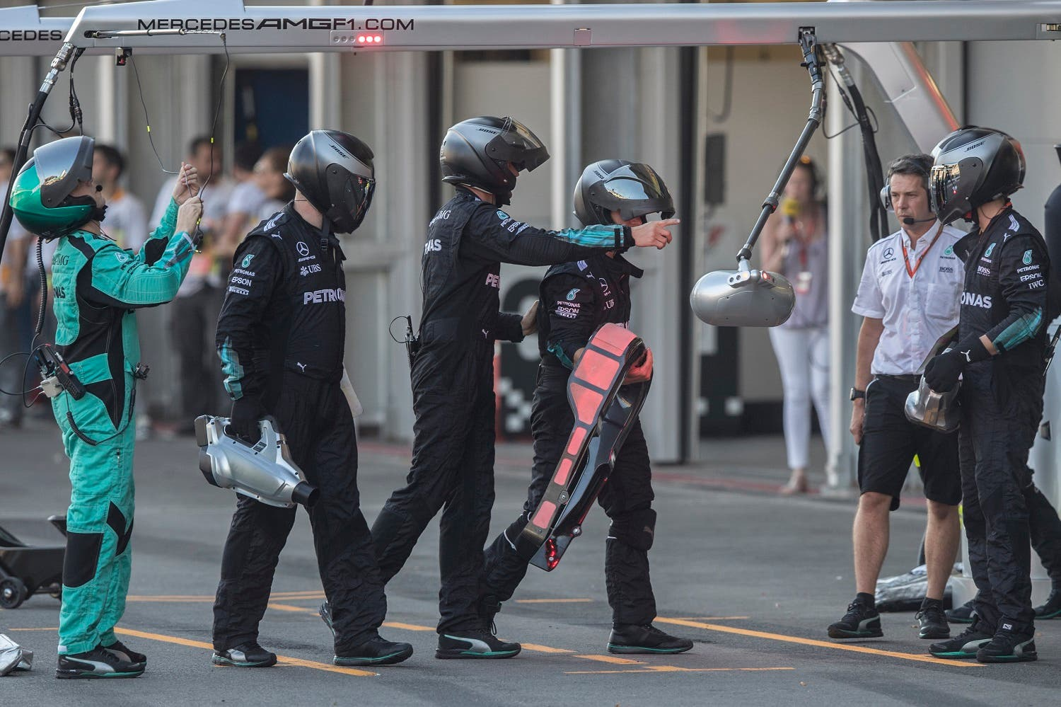 Mechanics carry the head rest of the car of Mercedes driver Lewis Hamilton of Britain in a pit stop at the Formula One Azerbaijan Grand Prix in Baku, on June 25, 2017. (AP)