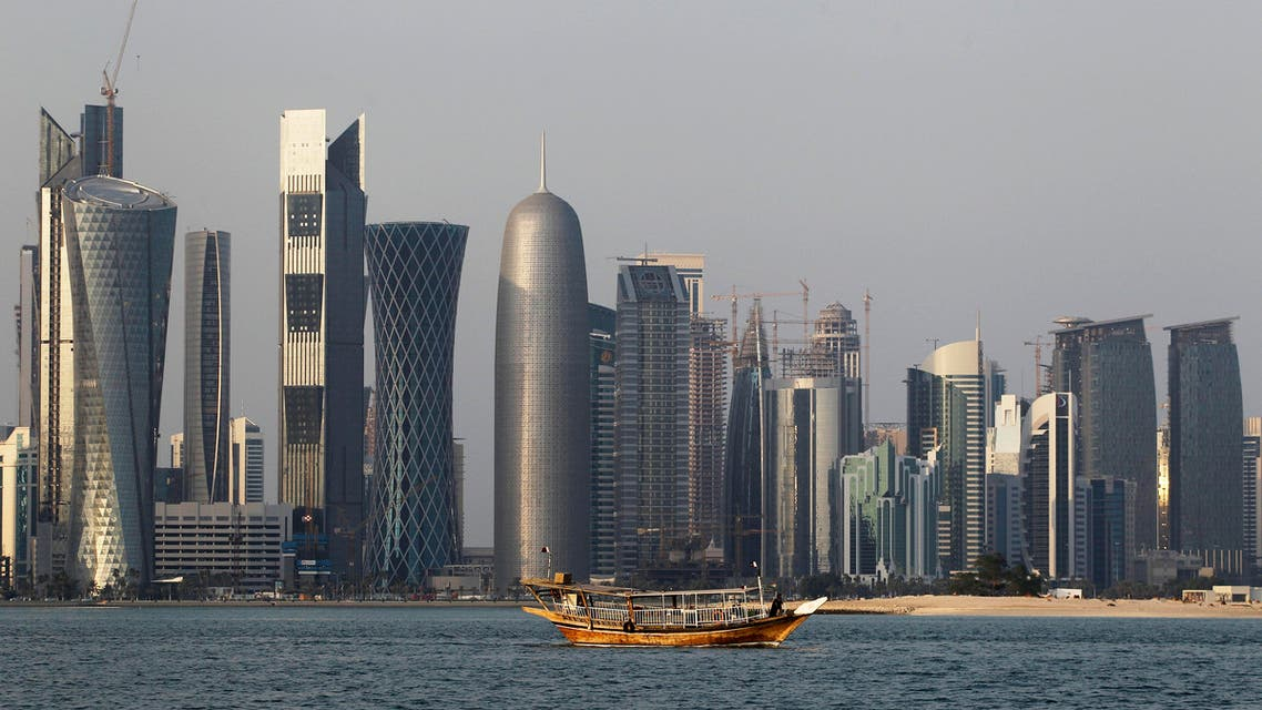 In this Thursday Jan. 6, 2011 file photo, a traditional dhow floats in the Corniche Bay of Doha, Qatar, with tall buildings of the financial district in the background. (AP)