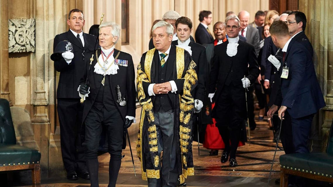 Gentleman Usher of the Black Rod, David Leakey (L) walks with Speaker of the House of Commons John Bercow (R) through the Central Lobby of the Palace of Westminster in London on June 21, 2017. (AFP)
