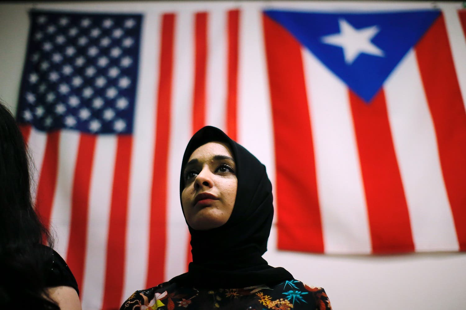 A woman attends a town hall meeting following a rally to protest restrictive guidelines issued by the US on who qualifies as a close familial relationship under the Supreme Court order on the Muslim and refugee ban at Union Square on June 29, 2017, in New York. (AFP)