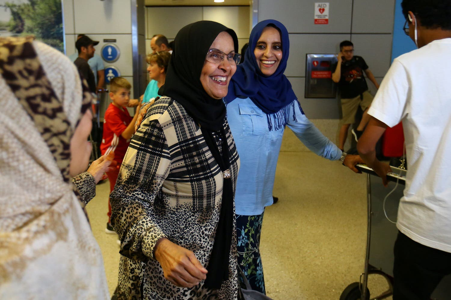 Hanadi Al-Hai (R) welcomes her mother traveling from Jordan on a Yemeni passport following the reinstatement by the US Supreme Court of portions of the executive order in Los Angeles, California, US, June 29, 2017. (Reuters)