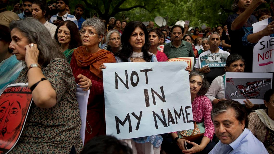 An Indian woman holds placard during a protest against a spate of violent attacks across the country targeting the Muslim minority, in New Delhi on June 28, 2017. (AP)