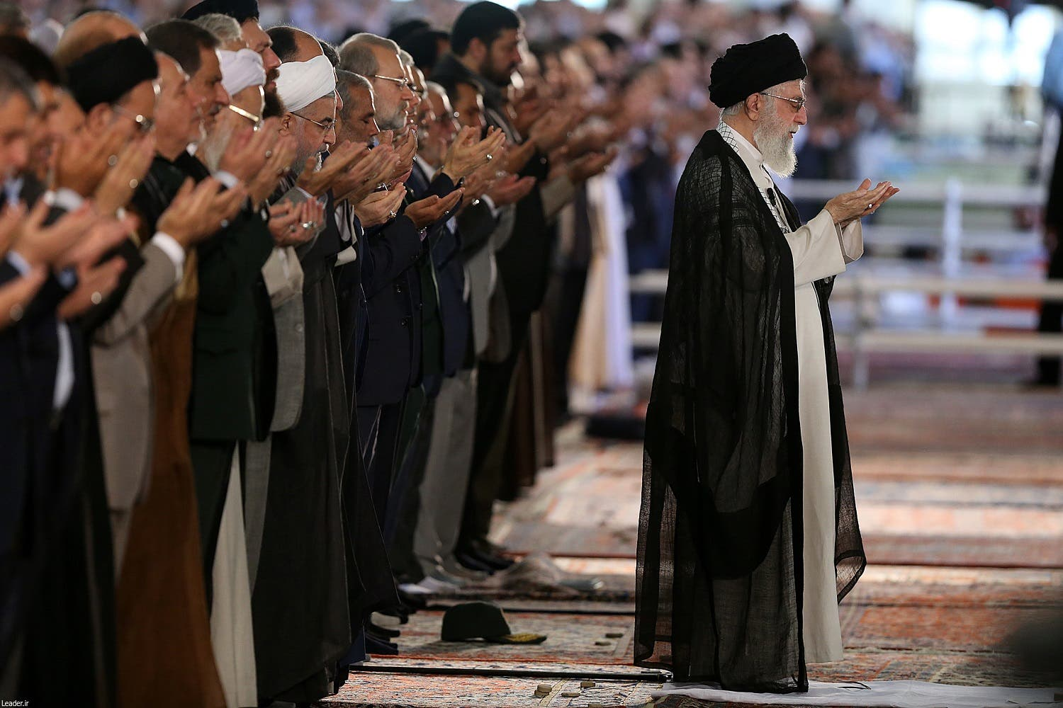 A handout picture released by the official website of the Iranian supreme leader Ayatollah Ali Khamenei shows him (R) leading the Eid al-Fitr prayers at the Imam Khomeini grand mosque in the capital Tehran on June 26, 2017. (AFP)
