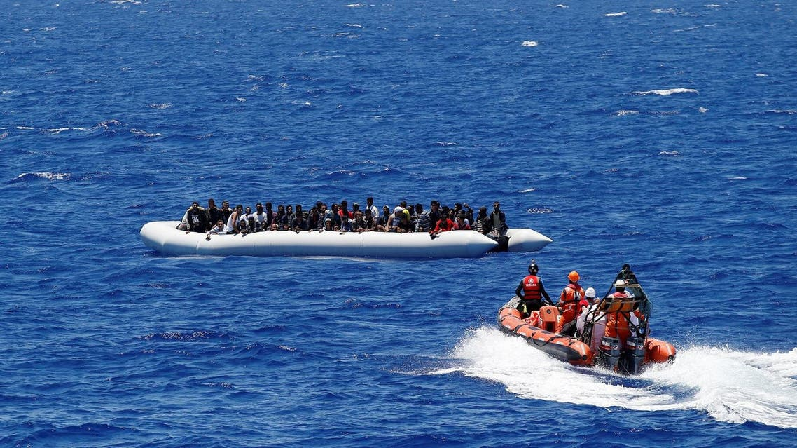 """Migrants on a dinghy are rescued by """"Save the Children"""" NGO crew from the ship Vos Hestia in the Mediterranean sea off Libya coast, June 15, 2017. REUTERS/Stefano Rellandini"""