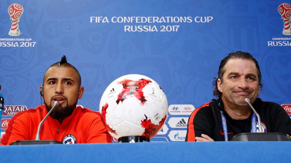 Chile's Arturo Vidal and coach Juan Antonio Pizzi during the press conference on July 1, 2017, in St. Petersburg, before the Confederations Cup  final on Sunday. (Reuters)