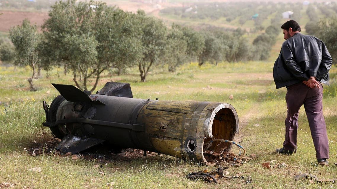 A man inspects a piece of a rocket that landed south of Daraa Al-Balad, Syria, April 5, 2017. (Reuters)
