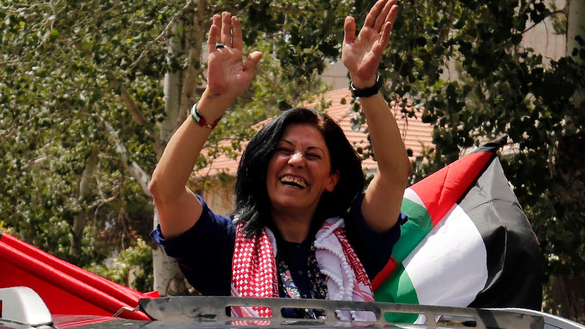 Prominent Palestinian lawmaker Khalida Jarrar (C) greets supporters in her hometown, the West Bank city of Ramallah, following her release from an Israeli jail on June 3, 2016, after serving a 15-month sentence for encouraging attacks against Israelis and violating a travel ban. AFP