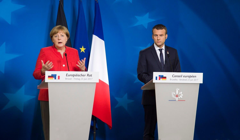 Merkel and Macron. (Supplied)