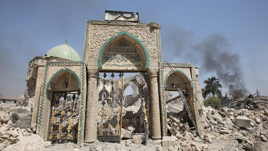 A picture taken on June 30, 2017, shows the destroyed gate of the Al-Nuri Mosque in the Old City of Mosul, as Iraqi government forces continue their offensive to retake the city from Islamic State (IS) group jihadists. IS blew up the mosque and the famed Al-Hadba (hunchback) leaning minaret on June 21 as Iraqi forces closed in. AHMAD AL-RUBAYE / AFP