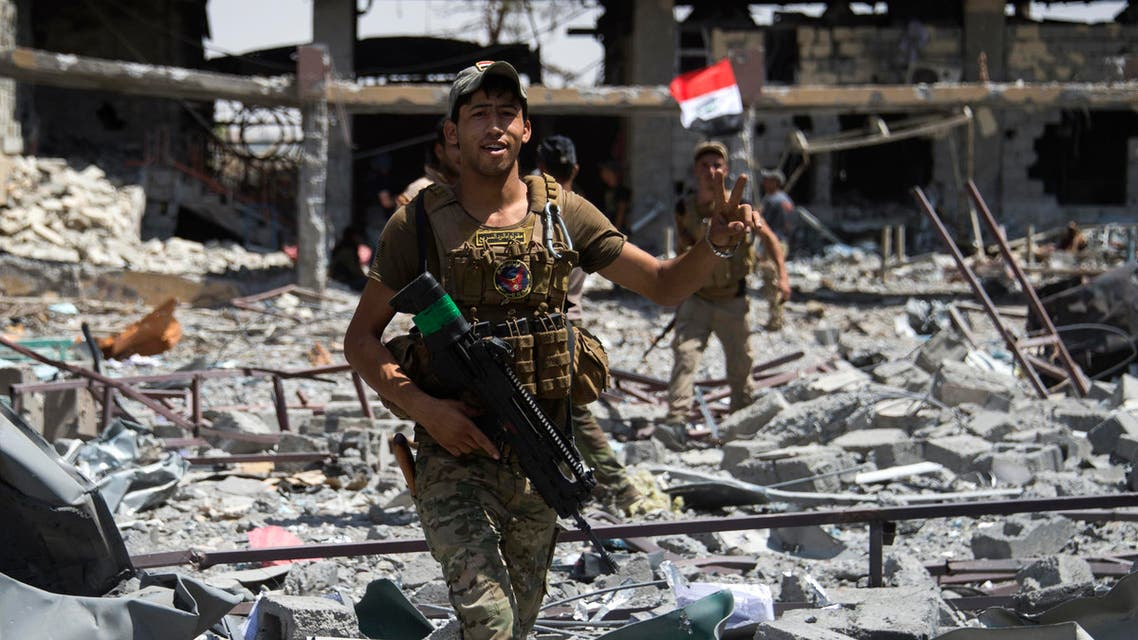 Members of Iraq's elite Rapid Response Division gesture as they patrol the Shifa neighbourhood, on the west bank of Mosul, on July 1, 2017. (AFP)