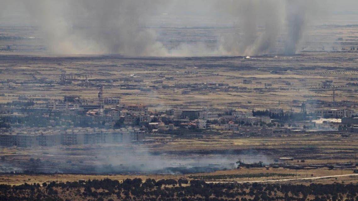 A picture taken from the Israeli-occupied Golan Heights shows smoke billowing from the Syrian side of the border on June 26, 2017. (AFP)