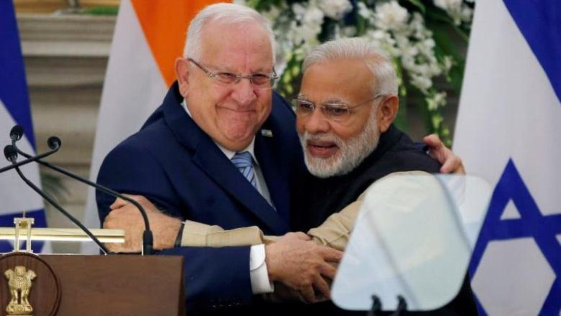 FILE PHOTO: Israeli President Reuven Rivlin (L) and India's Prime Minister Narendra Modi hug each other after reading their joint statement at Hyderabad House in New Delhi, India, November 15, 2016. REUTERS/Adnan Abidi/File Photo
