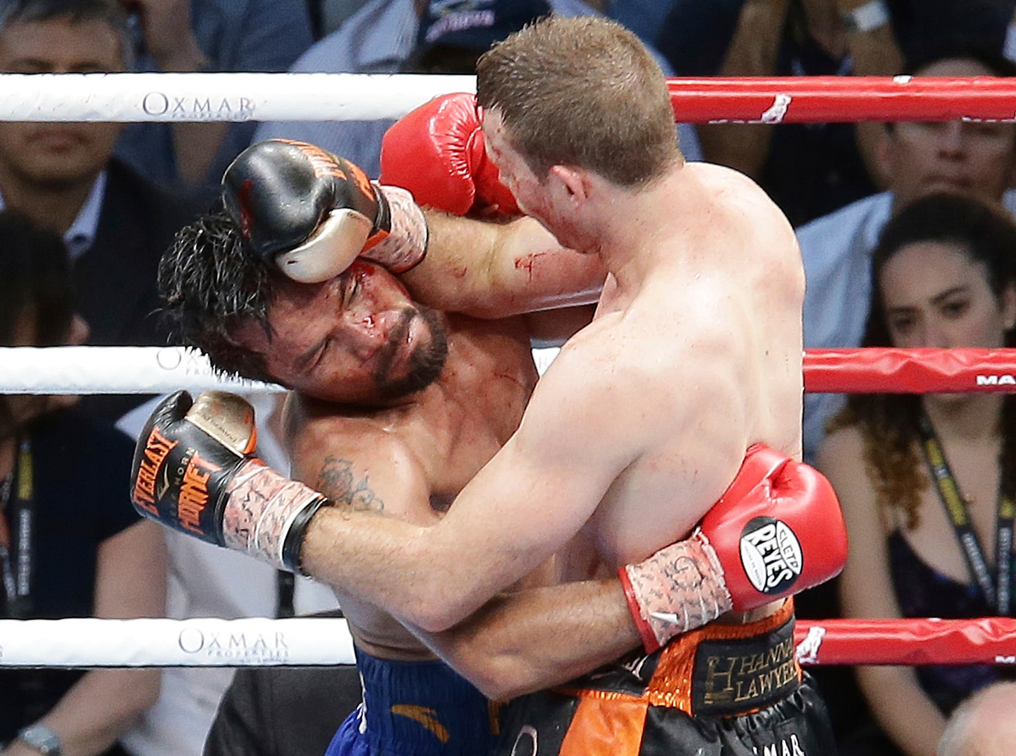 Manny Pacquiao of the Philippines, left, clinches with Jeff Horn of Australia, during their WBO World Welterweight title fight in Brisbane, Australia, Sunday, July 2, 2017. (AP)