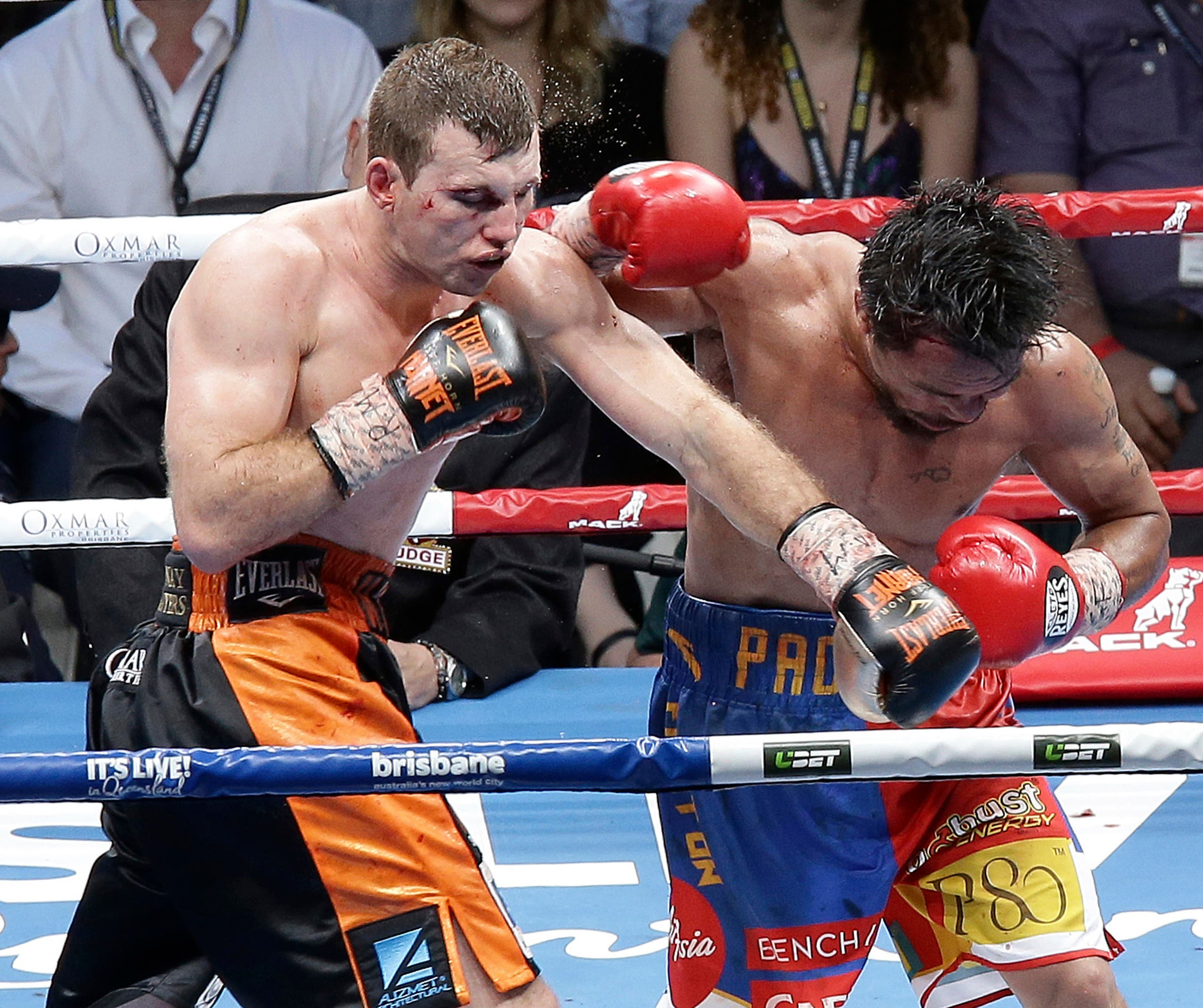Jeff Horn of Australia, left, lands a left to Manny Pacquiao of the Philippines, right, during their WBO World Welterweight title fight in Brisbane, Australia, Sunday, July 2, 2017. (AP)