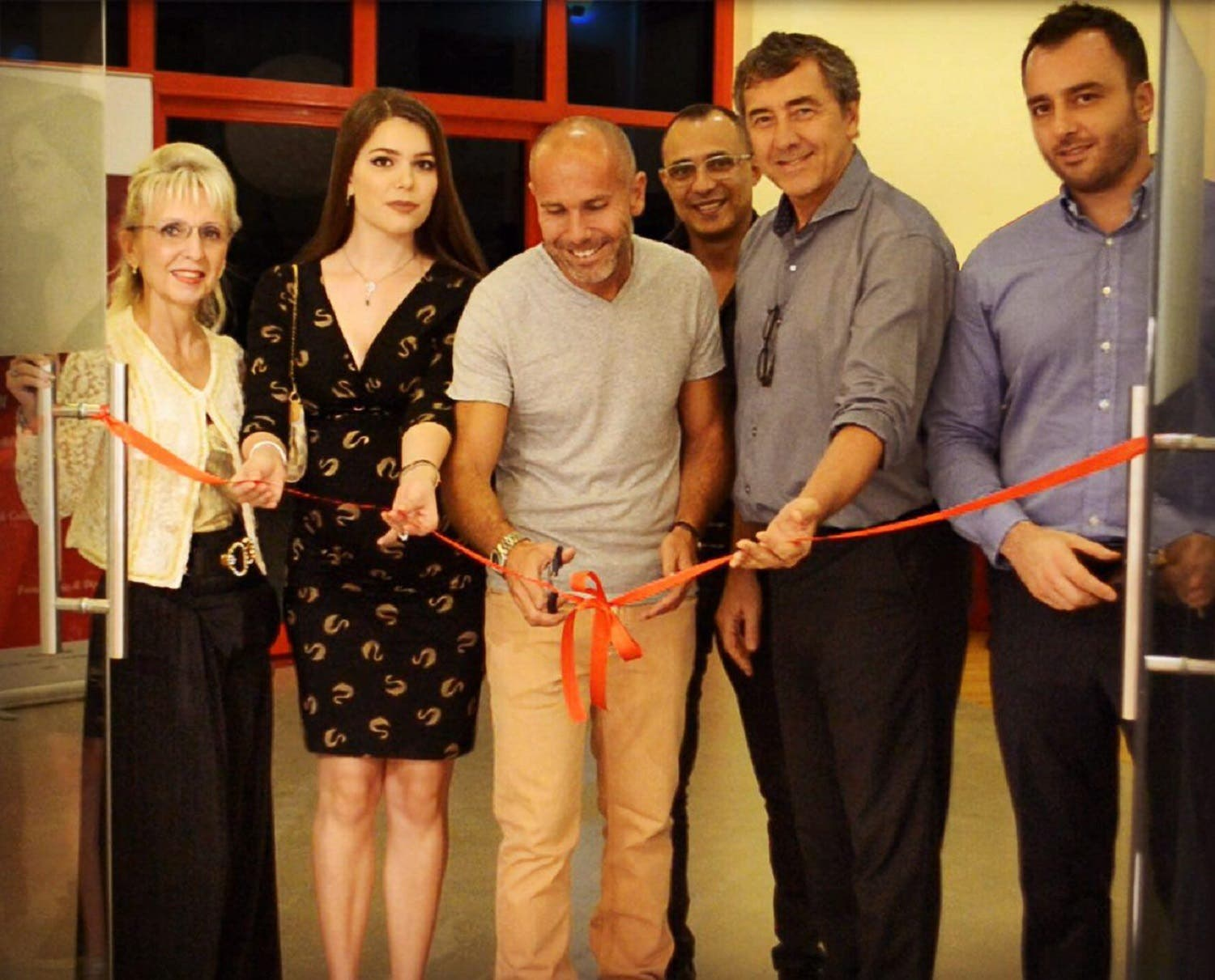 Boris Wilensky (centre) at the opening of his exhibition, along with the organizers at Alliance Francaise, Dubai. (Supplied)
