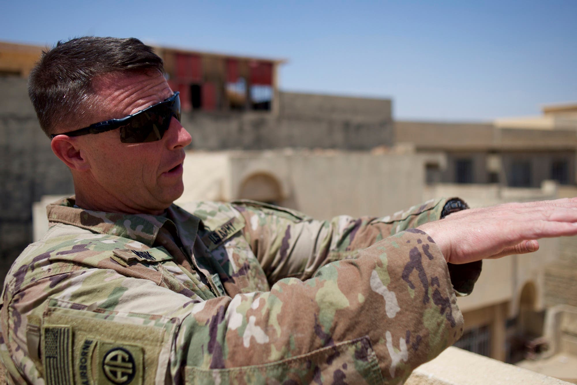Colonel Pat Work of the U.S. Army's 82nd airborne division looks at the skyline, as he meets with Iraqi commanders near the front lines, on the rooftop of a house in Mosul, Friday, June 30, 2017. (AP)