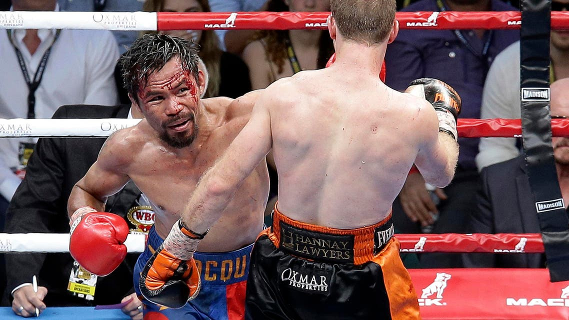 Manny Pacquiao of the Philippines, left, lands a left, to Jeff Horn of Australia, during their WBO World Welterweight title fight in Brisbane, Australia, Sunday, July 2, 2017. (AP)