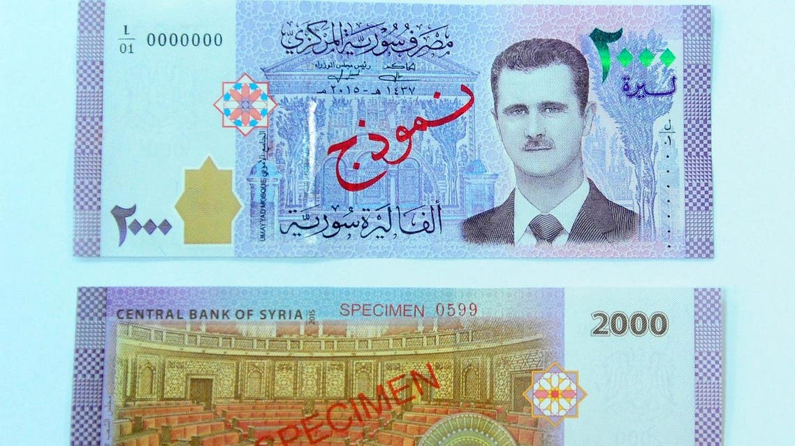 Portrait of Syria's President Bashar al-Assad is seen printed on the new Syrian 2,000-pound banknote that went into circulation on on July 2, 2017. (Reuters)