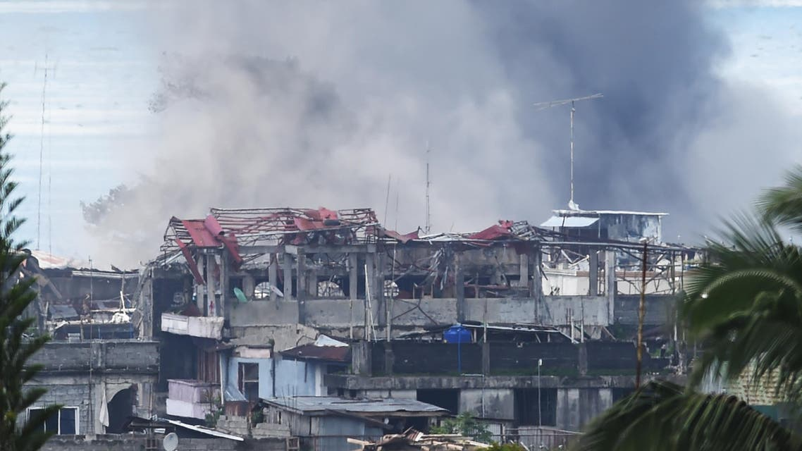Black smoke billows from burning houses after an aerial bombing by the Philippine Air Force on militant Islamist positions in Marawi on the southern island of Mindanao on June 27, 2017. (AFP)