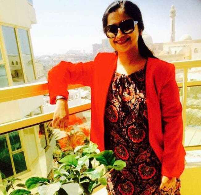 The poet in the balcony of her Bahrain home with the Grand Mosque in the background. (Supplied)