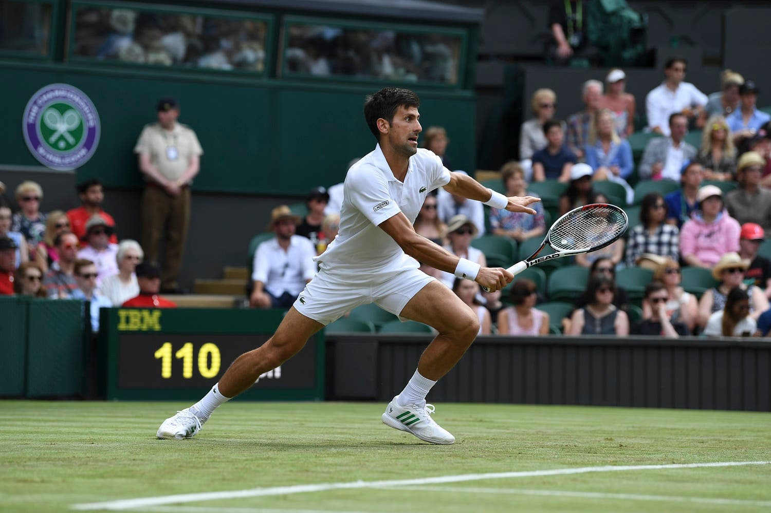 Serbia's Novak Djokovic returns against Slovakia's Martin Klizan during their men's singles first round match on the second day of the 2017 Wimbledon Championships at The All England Lawn Tennis Club in Wimbledon, southwest London, on July 4, 2017. (AFP)