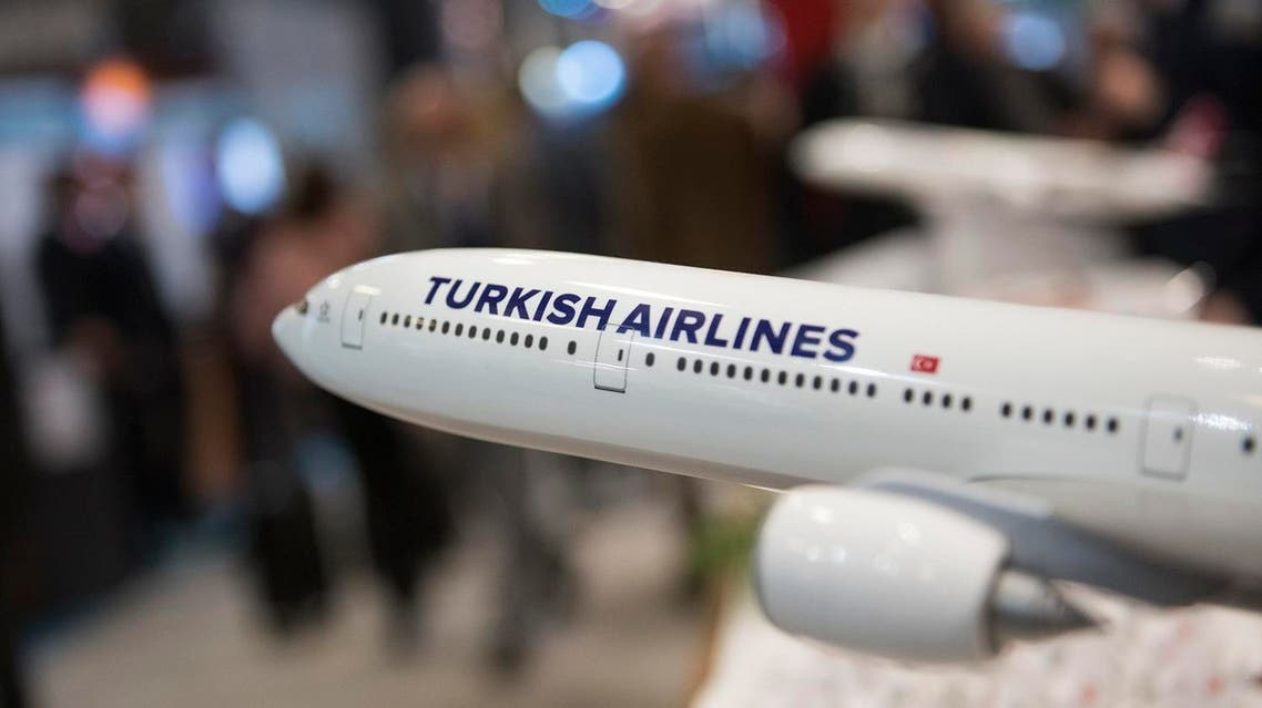 Visitors inform themselves at a stand of Turkish Airlines at the International Tourism Trade Fair (ITB) on March 8, 2017. AFP