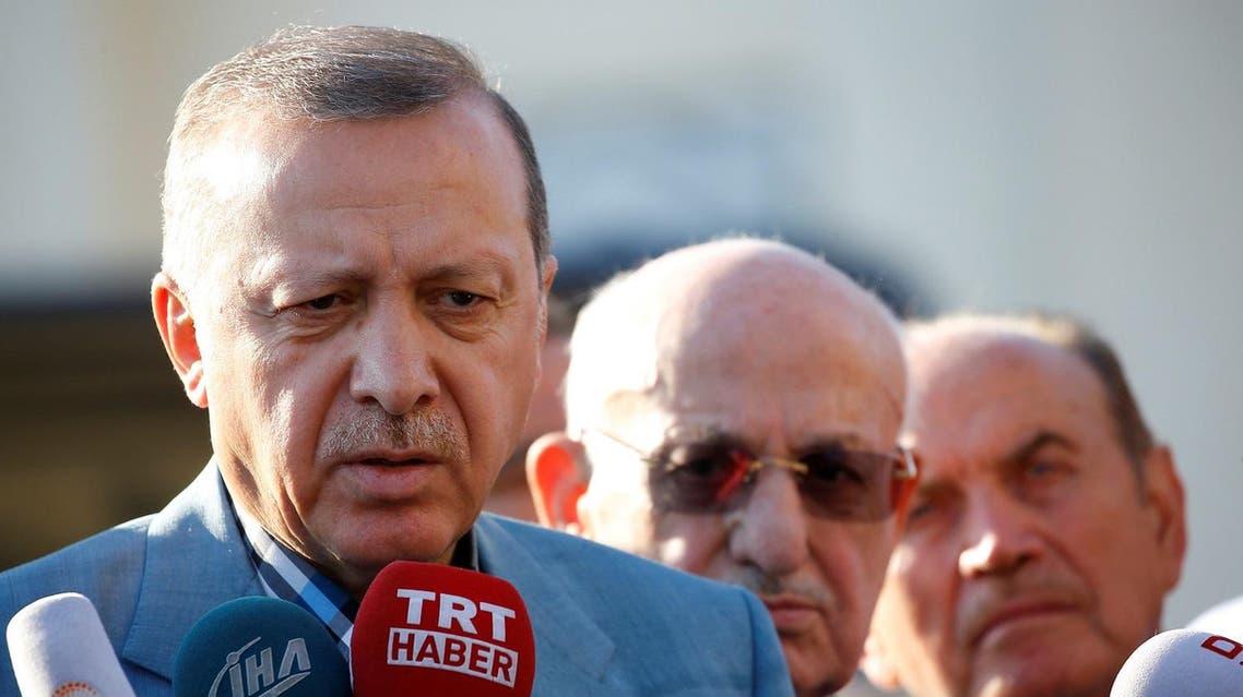 Turkey's President Tayyip Erdogan talks to media after the Eid al-Fitr prayers in Istanbul, Turkey, June 25, 2017. REUTERS/Murad Sezer