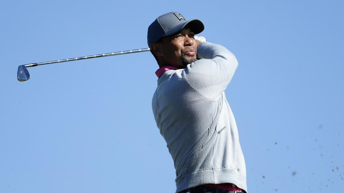 """(FILES) This file photo taken on January 26, 2017 shows Tiger Woods plays his shot from the 15th tee during the first round of the Farmers Insurance Open at Torrey Pines North in San Diego, California. Tiger Woods won't be hosting this week's PGA National tournament as he continues treatment to manage medications following an impaired driving arrest, and players on June 28, 2017 praised his commitment to getting better. """"It's really cool to see what he's doing in terms of he's handling what he's dealing with and he's taking it seriously,"""" said 12th-ranked Justin Thomas, part of Sunday's final US Open pairing two weeks ago. (AFP)"""