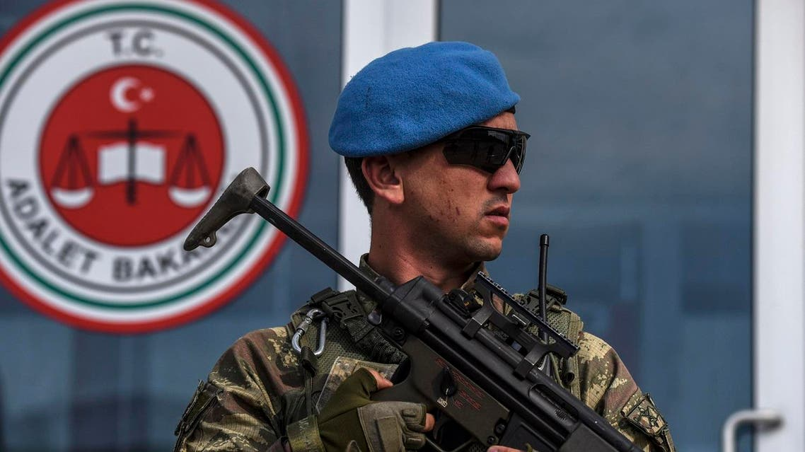 A member of Turkish special force stands guard at the entrance of the courthouse at the Silivri district in Istanbul, on May 29, 2017, during the opening of the 23 army officers suspected of planing last year coup. The trial against 23 army officers suspected of planing last year coup of July 15, 2016, opens on May 29, 2017. (Reuters)