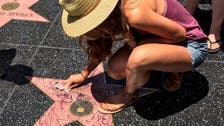 Student starts viral trend after she stops to clean Trump's Hollywood star