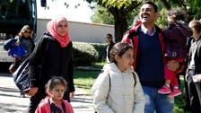 First Syria refugees land in France under corridor scheme
