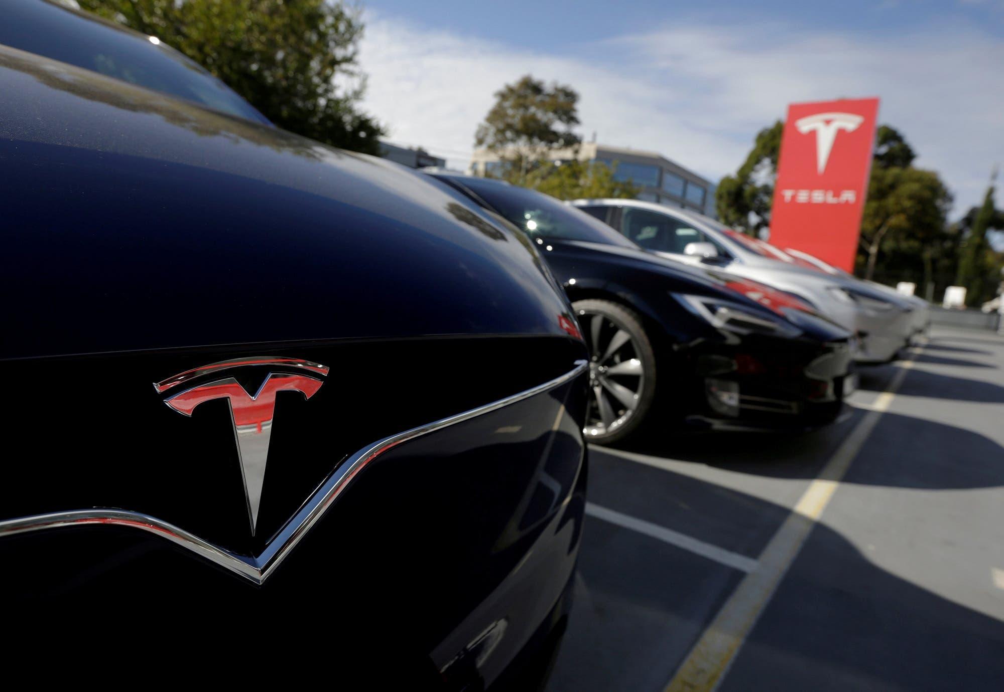 A Tesla Model X is photographed alongside a Model S at a Tesla electric car dealership in Sydney, Australia, May 31, 2017. (Reuters)