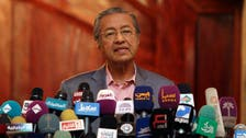 Malaysia's opposition leader Mahathir under investigation for 'fake news'