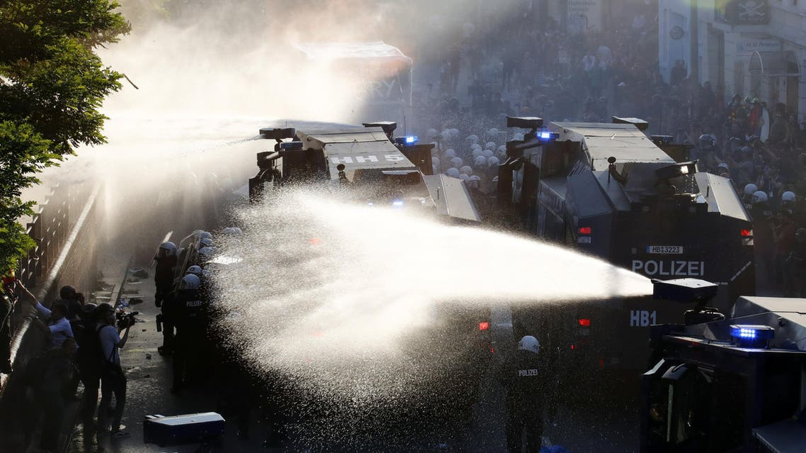 German riot police use water cannons against protesters during the demonstrations during the G20 summit in Hamburg, Germany, July 6, 2017