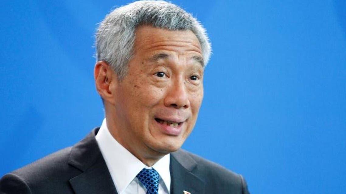 لي هسين لونغ رئيس وزراء سنغافورة في مؤتمر صحفي في برلين