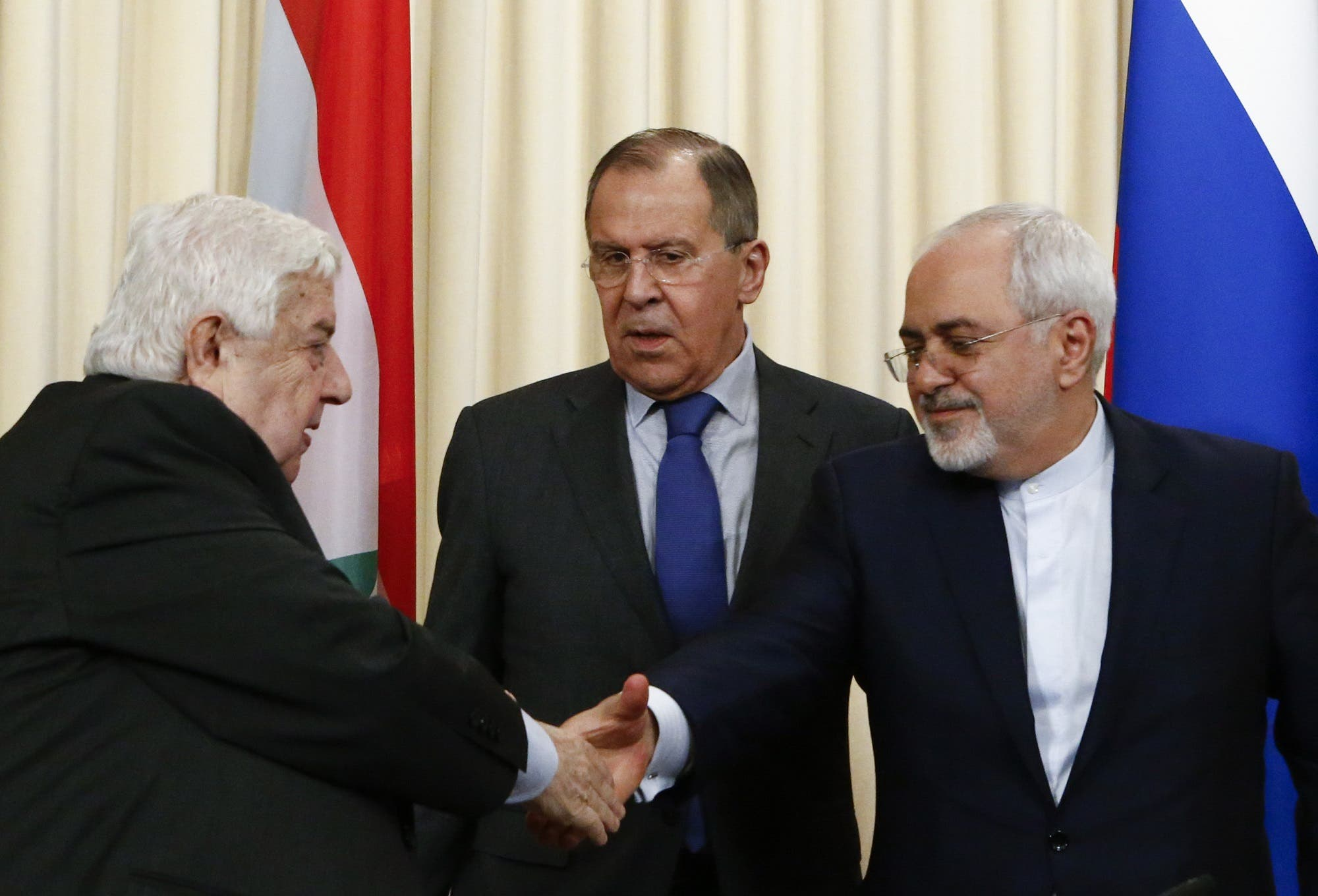 Foreign Ministers, Sergei Lavrov (C) of Russia, Walid al-Muallem (L) of Syria and Mohammad Javad Zarif of Iran, attend a news conference in Moscow, Russia, April 14, 2017. (Reuters)