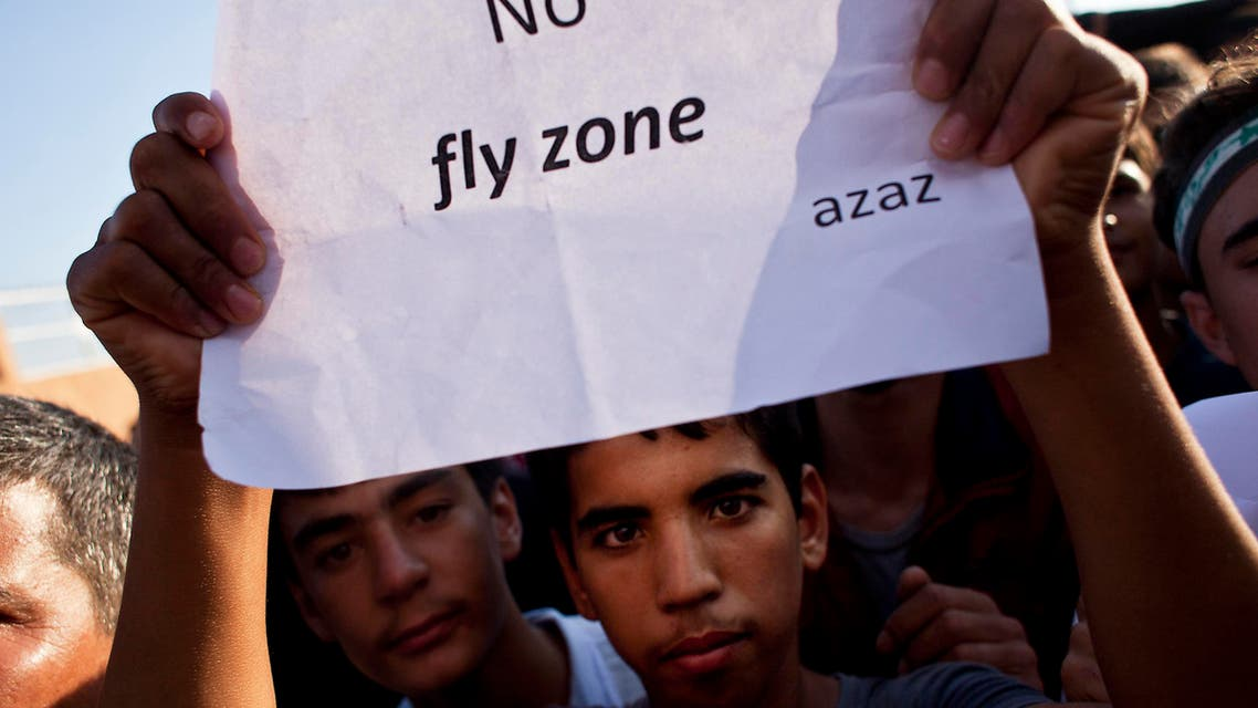 A young Syrian protester holds a sign calling for a no-fly zone during a demonstration in support of the Free Syrian Army near the Syrian-Turkish border crossing of Al-Salama on September 7, 2012. (AFP)