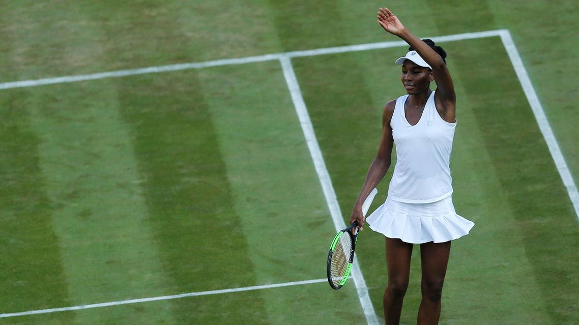 Venus Williams celebrates winning her second round match against China's Qiang Wang on July 5. (Reuters)