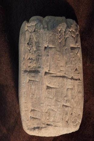 A cuneiform tablet, an ancient clay artifact that originated in modern-day Iraq is seen in this undated handout photo obtained by Reuters July 5, 2017. United States Attorney's Office Eastern District of New York/Handout via REUTERS
