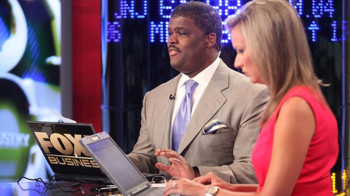 Hosts Charles Payne and Sandra Smith report on the stock market opening at FOX Studios on August 5, 2011 in New York City. (File photo: AFP)