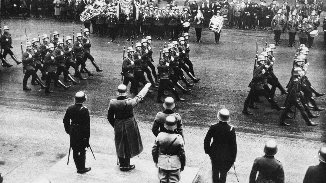 Squads of Berlin police goose-step past the reviewing stand as a high military official gives them the Nazi salute during a parade in the Lustgarten, Berlin, March 20, 1934. (File photo: AP)