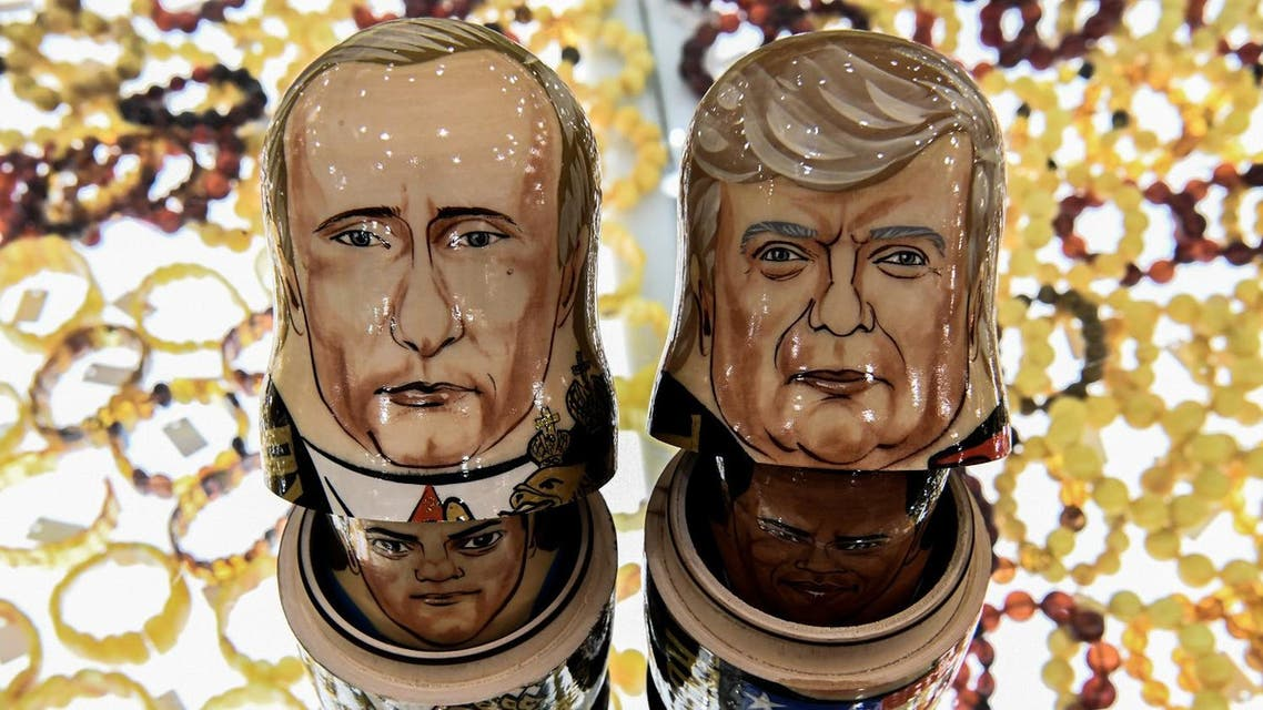 This picture taken on July 6, 2017, shows traditional Russian wooden nesting dolls, called Matryoshka dolls, depicting President Trump (R) and President Putin at a gift shop in central Moscow. (AFP)
