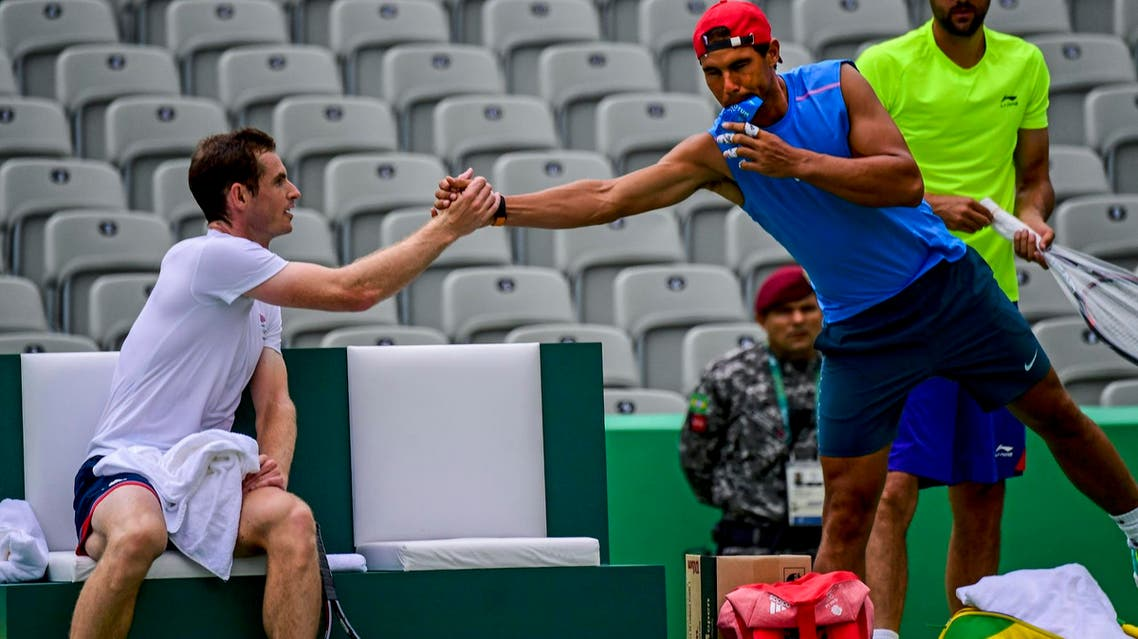 Andy Murray (L) shakes hands with Rafael Nadal after a training session at the Olympic Tennis Center in Rio de Janeiro on August 3, 2016. (AFP)