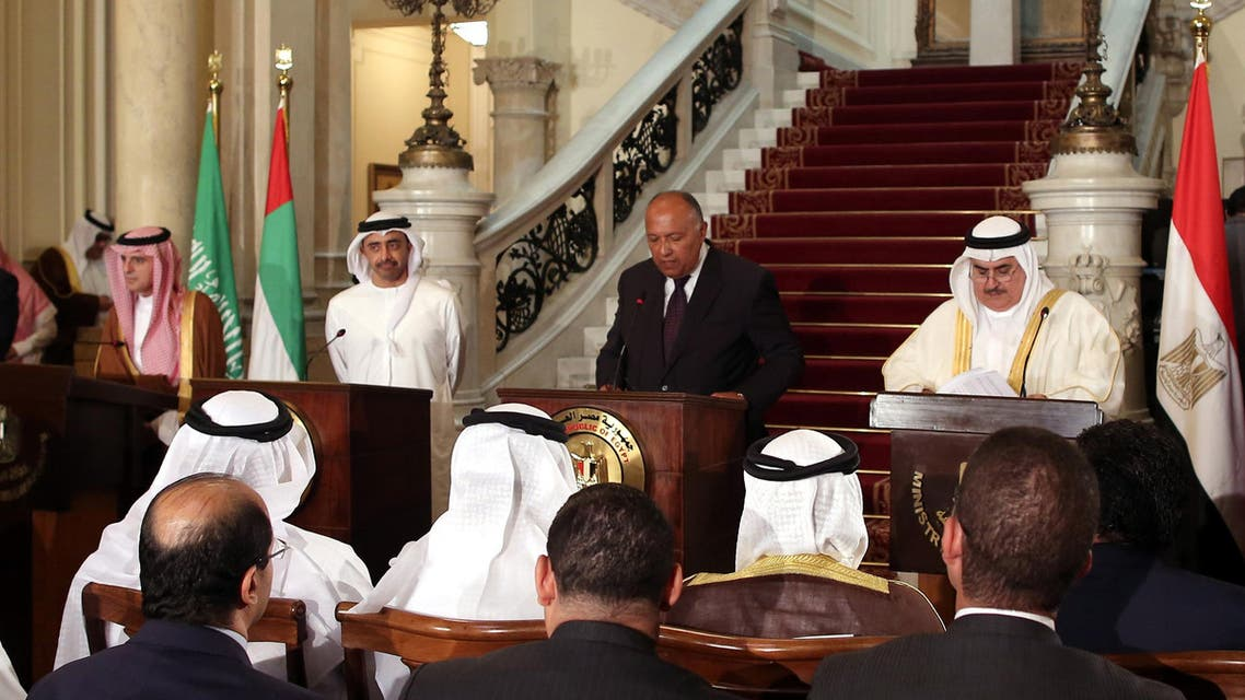 """Egyptian Foreign Minister Sameh Shoukry (C) reads a statement while giving a joint press conference with Saudi Foreign Minister Adel al-Jubeir (L), UAE Minister of Foreign Affairs and International Cooperation Abdullah bin Zayed Al-Nahyan (2nd-L), and Bahraini Foreign Minister Khalid bin Ahmed al-Khalifa (3rd-R) after their meeting in the Egyptian capital Cairo on July 5, 2017, discussing the Gulf diplomatic crisis with Qatar, as Doha called for dialogue to resolve the dispute. The foreign ministers of Egypt, Saudi Arabia, Bahrain and the United Arab Emirates """"regret the negative response from Qatar,"""" they said in the statement read out by Egyptian foreign minister Sameh Shoukry on July 5, 2017. The Saudi foreign ministry had said earlier that it had received Qatar's response to a 13-point list of demands issued on June 22 -- which include Doha ending support for the Muslim Brotherhood and closing broadcaster Al-Jazeera -- and would respond """"at the right time"""". Khaled ELFIQI / POOL / AFP"""